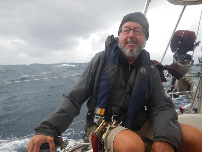 Scuppers at the helm sailing down the Wild Coast of Africa